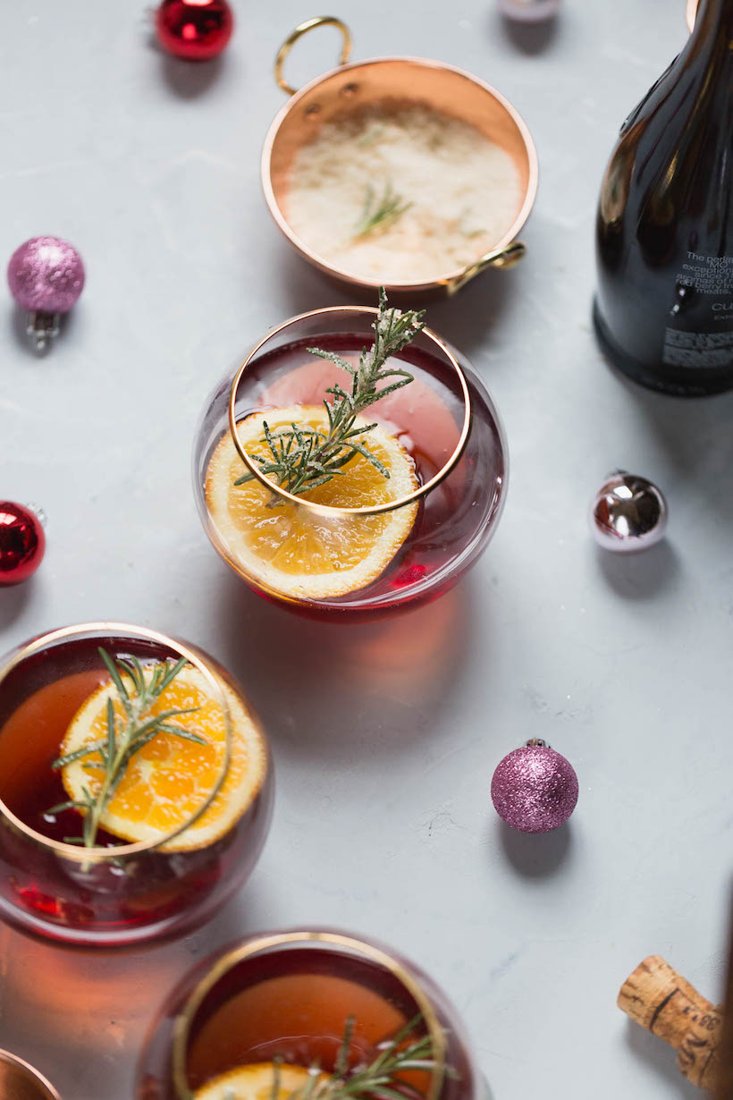 cranberry orange mimosa with candied rosemary