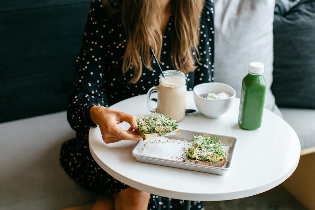 avocado toast and green juice at juice society in austin