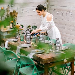 Chanel Dror setting the table at the CS Bungalow in Austin, Texas.