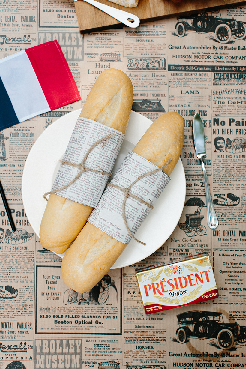newspaper wrapped baguettes