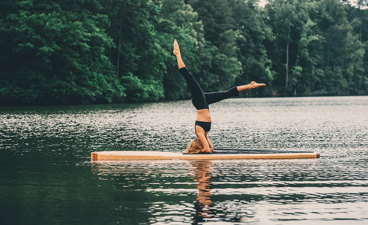 Angel Marya on a wooden stand up paddleboard
