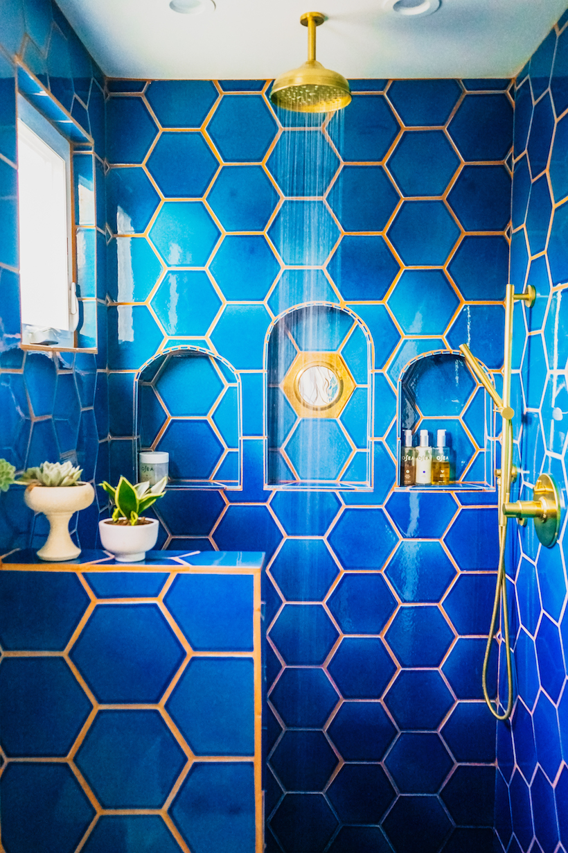 justina blakeney's blue hex tiled master bath