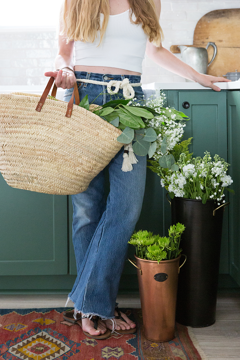 straw market bag and flowers