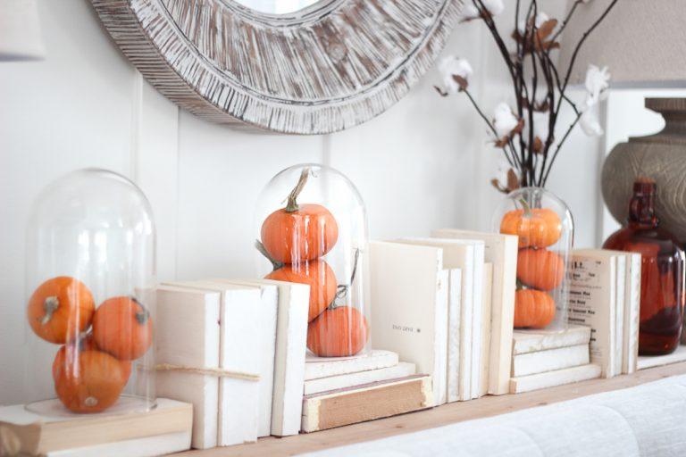 halloween decorations mini pumpkins on the mantle