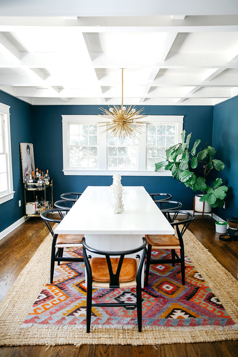 Emily Schuman's navy living room in her Los Angeles home