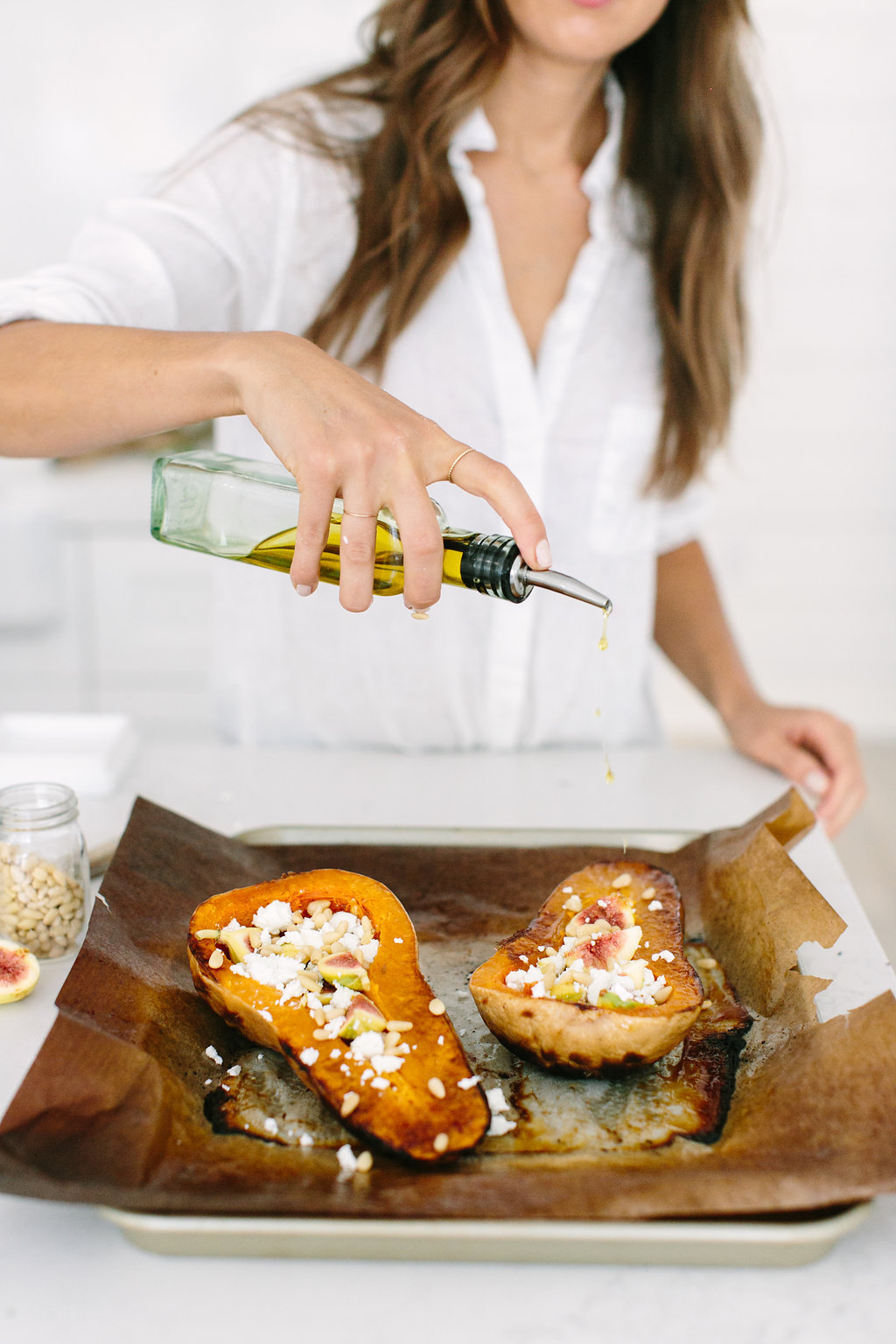 Roasted & Stuffed Butternut Squash filled with Pesto, Figs, & Goat Cheese