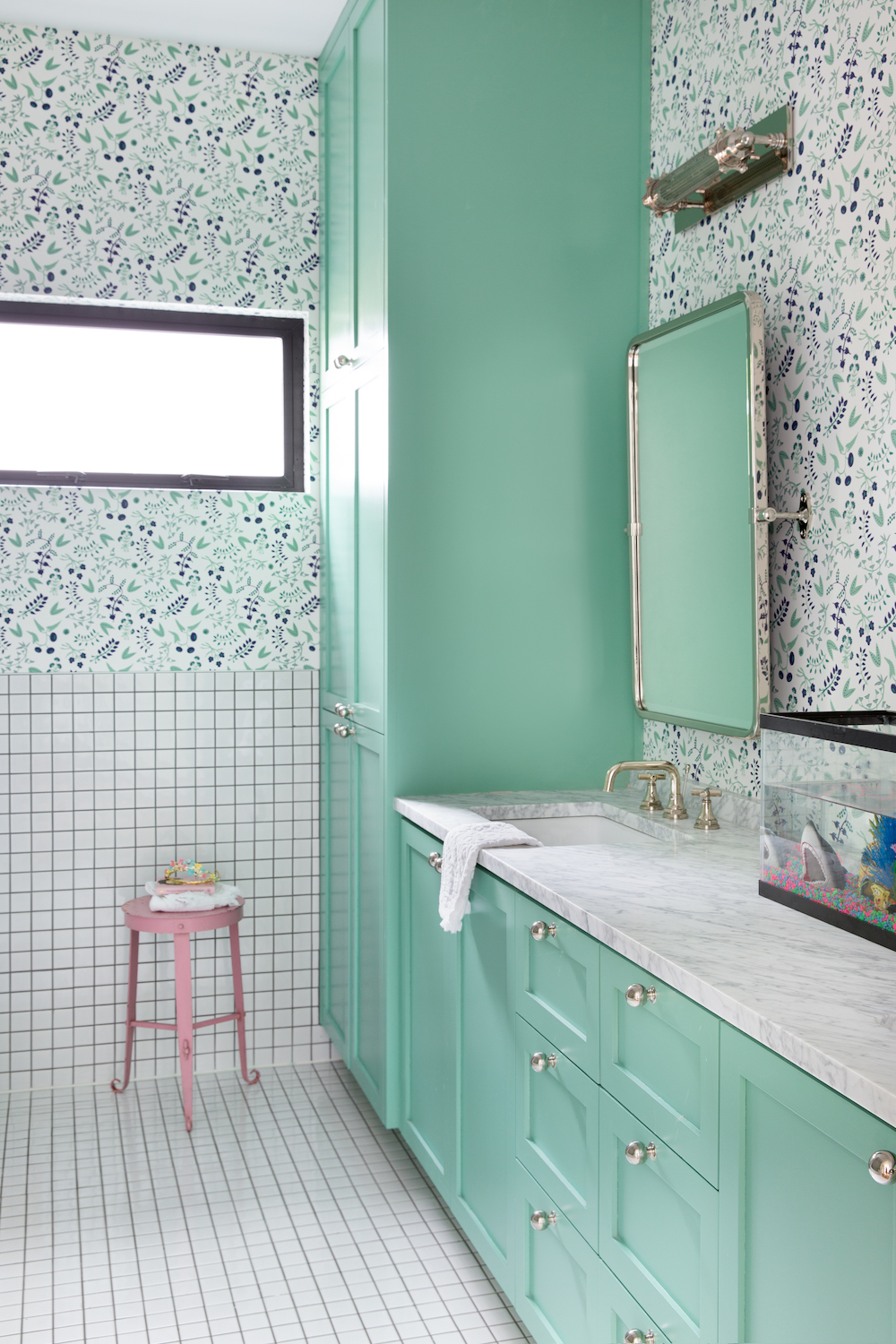fun kids bath with turquoise cabinets and tile
