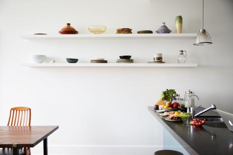 minimal white floating shelves