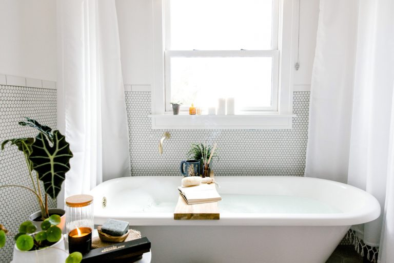 simply chocolate, self care, bath, spa, candle, book, plants, white bathroom