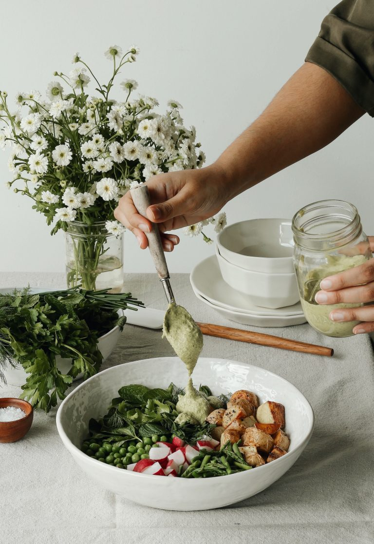 spring herbs and roasted potato salad with tahini green goddess dressing