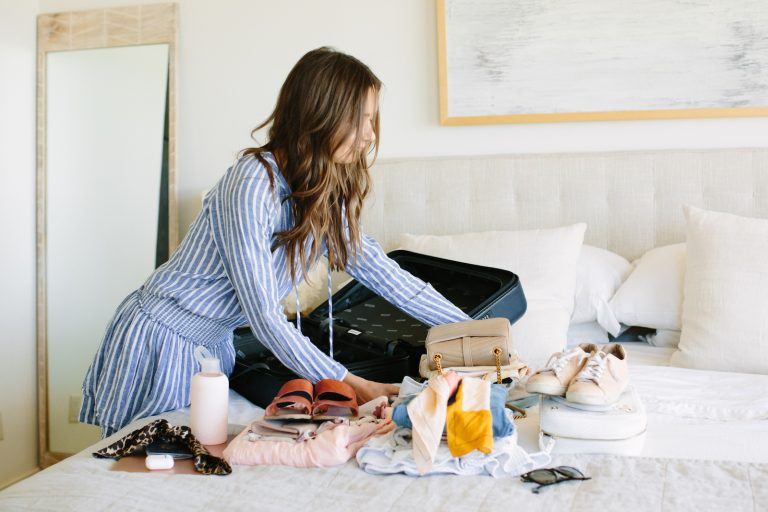 camille styles packing in an away suitcase carryon