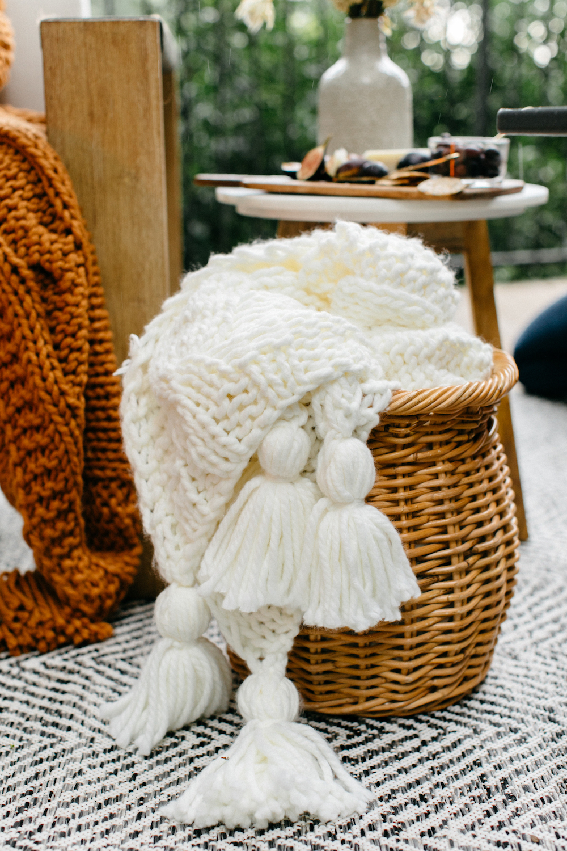 cozy blankets in baskets