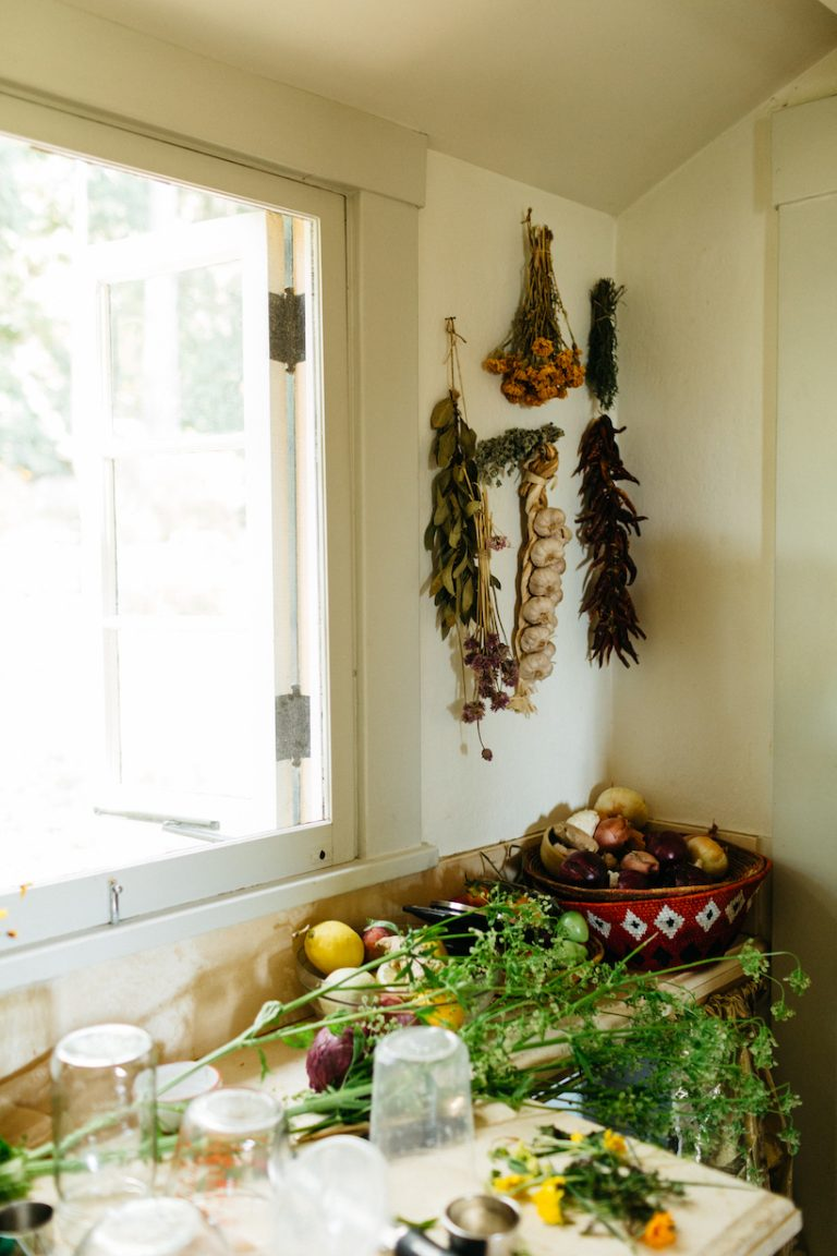 hanging garlic and dried herbs in loria stern kitchen