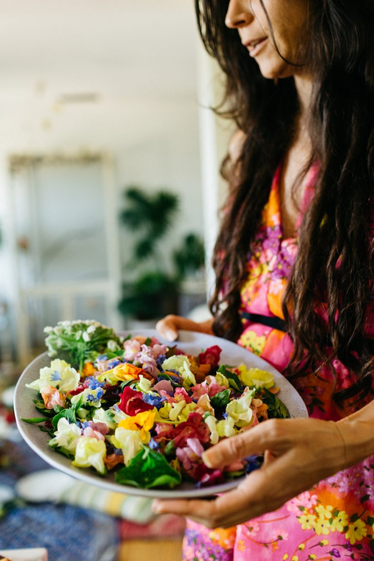salad garnished with edible flowers at loria stern dinner party