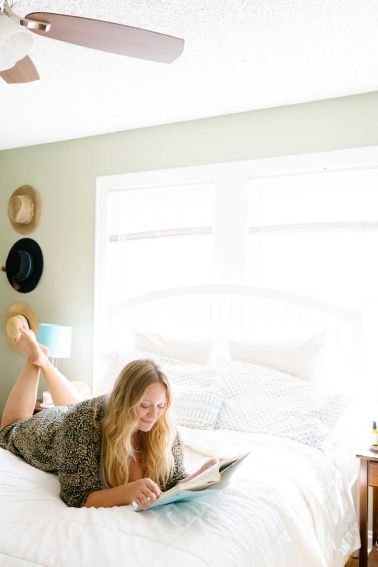 beth hitchcock reading in bedroom, relaxing at home