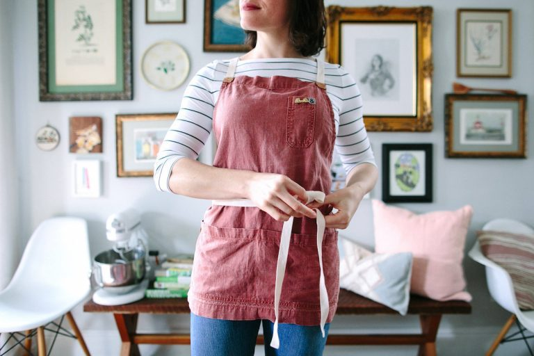 Designate yourself as the hostess with a special apron.