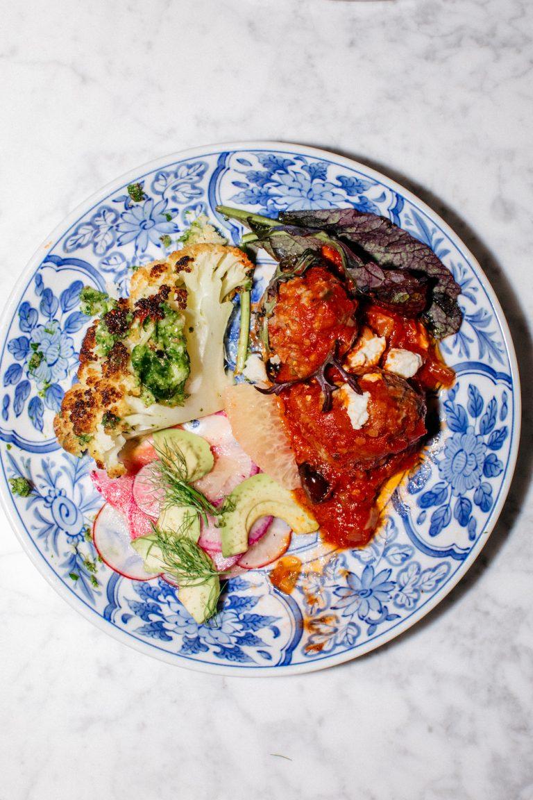 lamb meatballs and roasted cauliflower, mediterranean menu at dinner party in LA, whole boiled artichoke
