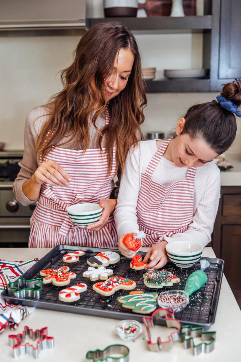 camille and daughter phoebe baking christmas cookies in kitchen