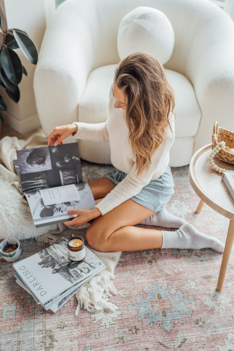 camille styles bedroom, reading magazines and cozy fall candle