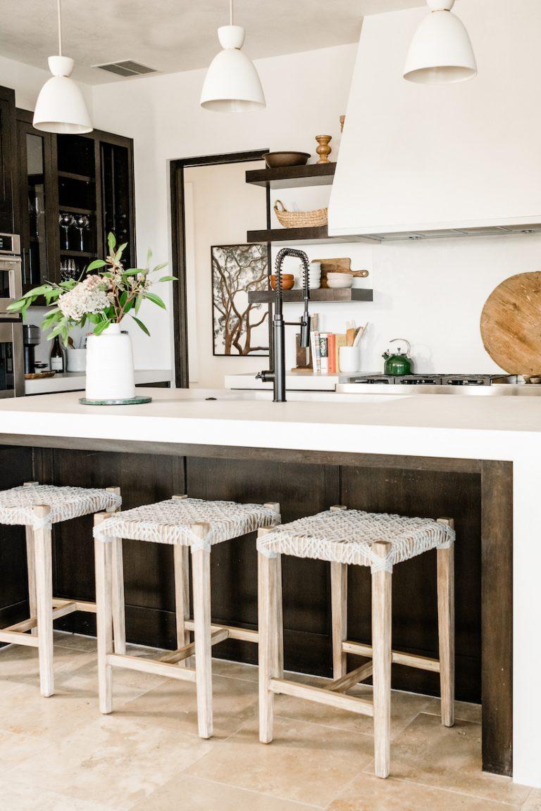 white caesarstone kitchen island with barstools
