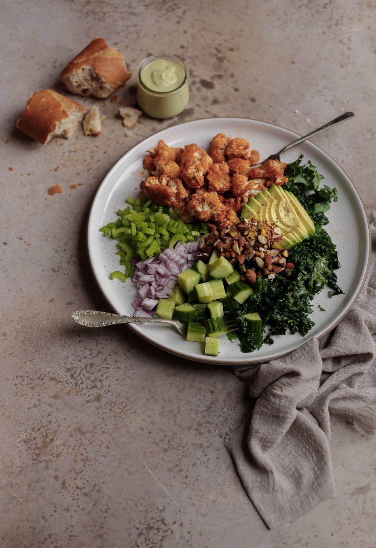 buffalo cauliflower chopped salad with basil garlic tahini dressing