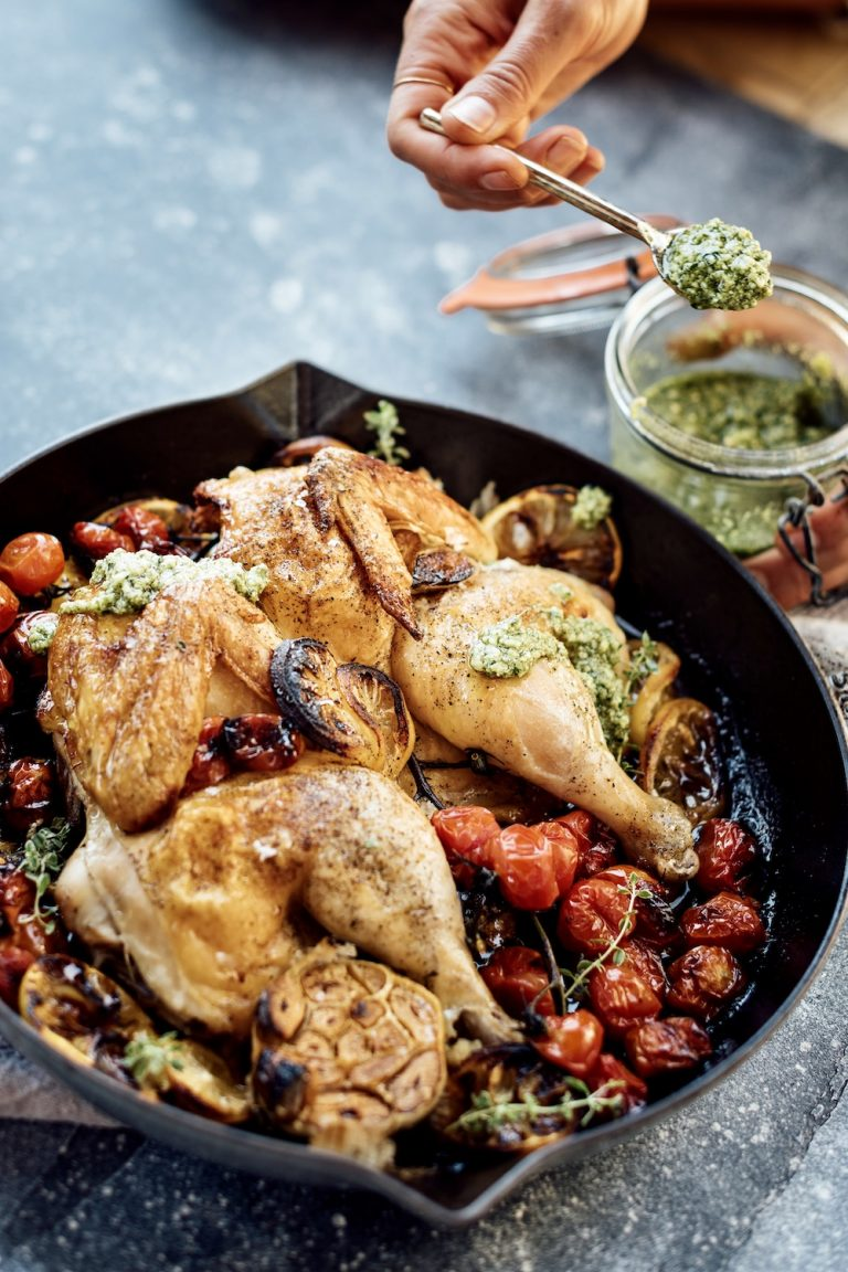 roast chicken with tomatoes, lemon and cilantro green salsa - the best roast chicken recipe for crispy skin and juicy flavor