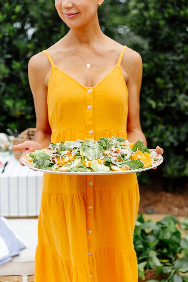 summer backyard dinner party with target, salad, yellow dress