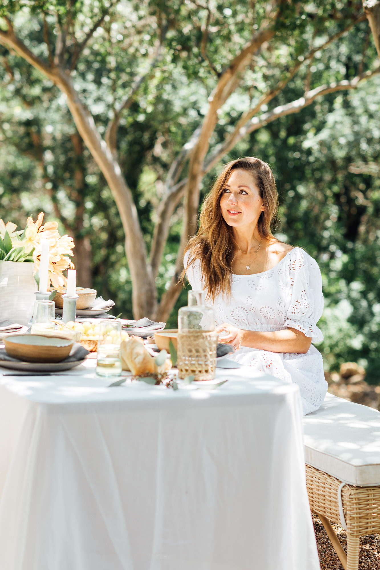 summer table setting ideas, Camille Styles summer dinner party table in backyard with trees