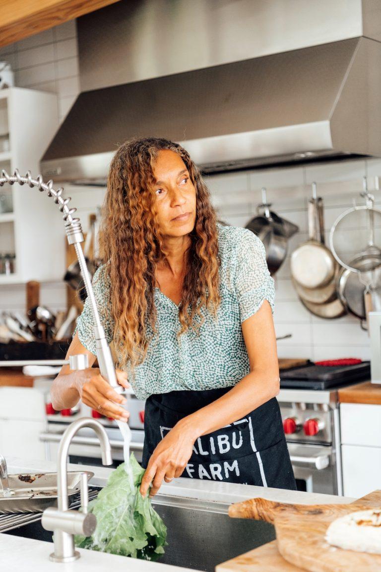 Helene Henderson of Malibu Farm at her home, washing veggies in the kitchen