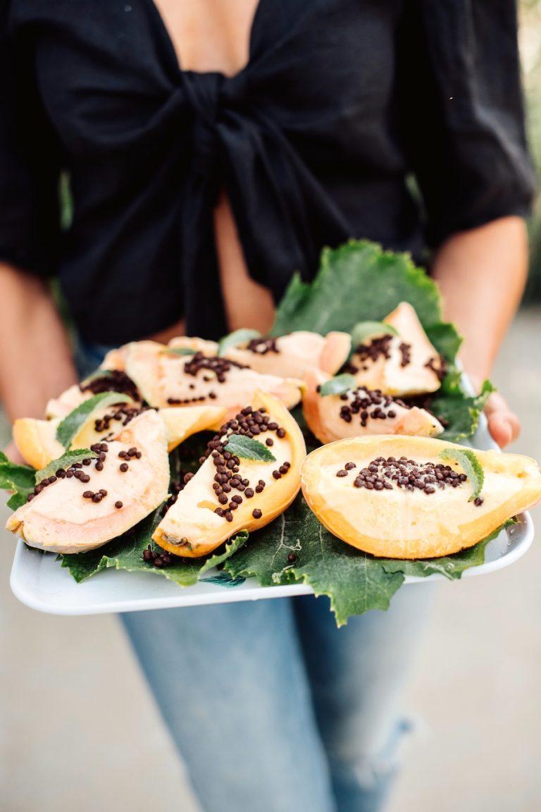 fruity sorbet in hollowed out papaya, summer dessert, malibu farm dinner party