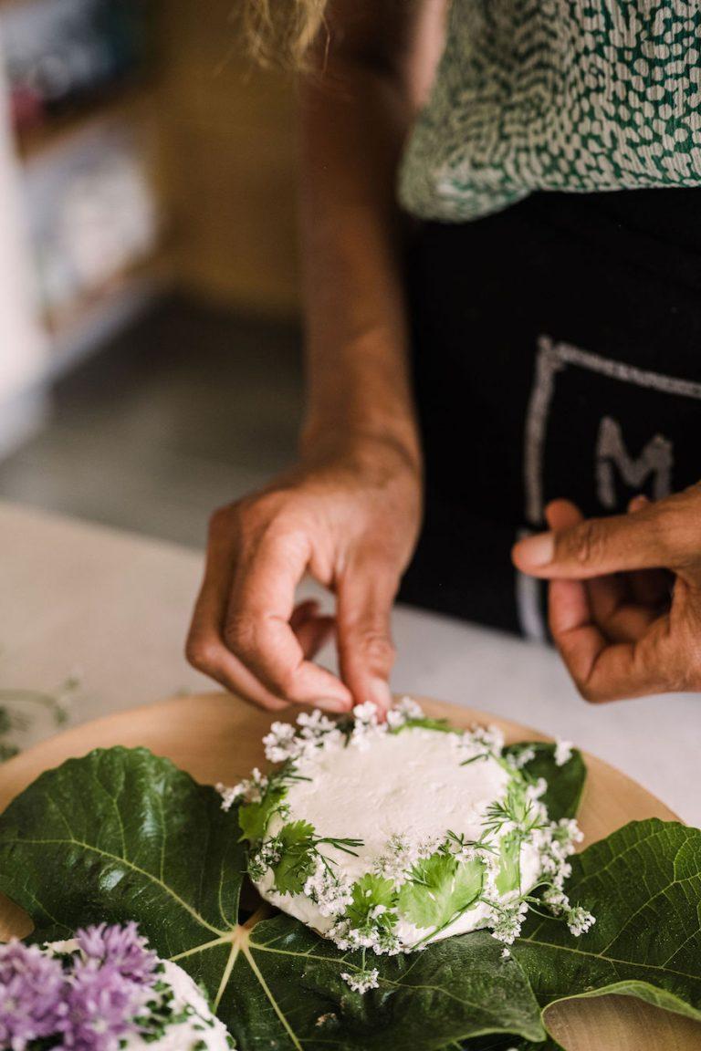 garnishing a cheese plate with edible flowers - Helene Henderson - Malibu Farm