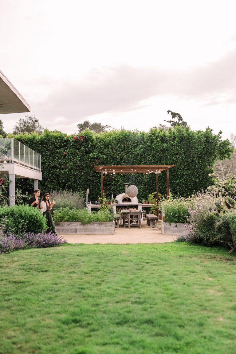 beautiful backyard with covered terrace and pizza oven - helene henderson home - malibu farm