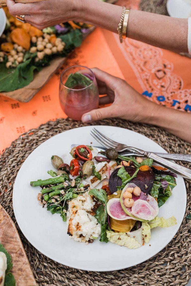 grilled fish with olives colorful plate from malibu farm sunrise to sunset - summer dinner party, fresh veggies, helene henderson -malibu farm