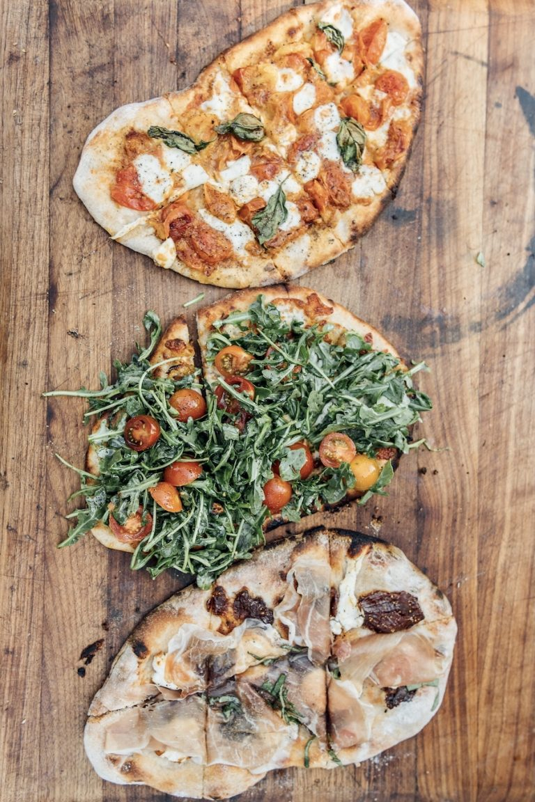 charred pizzas from the pizza oven at plumcot farm