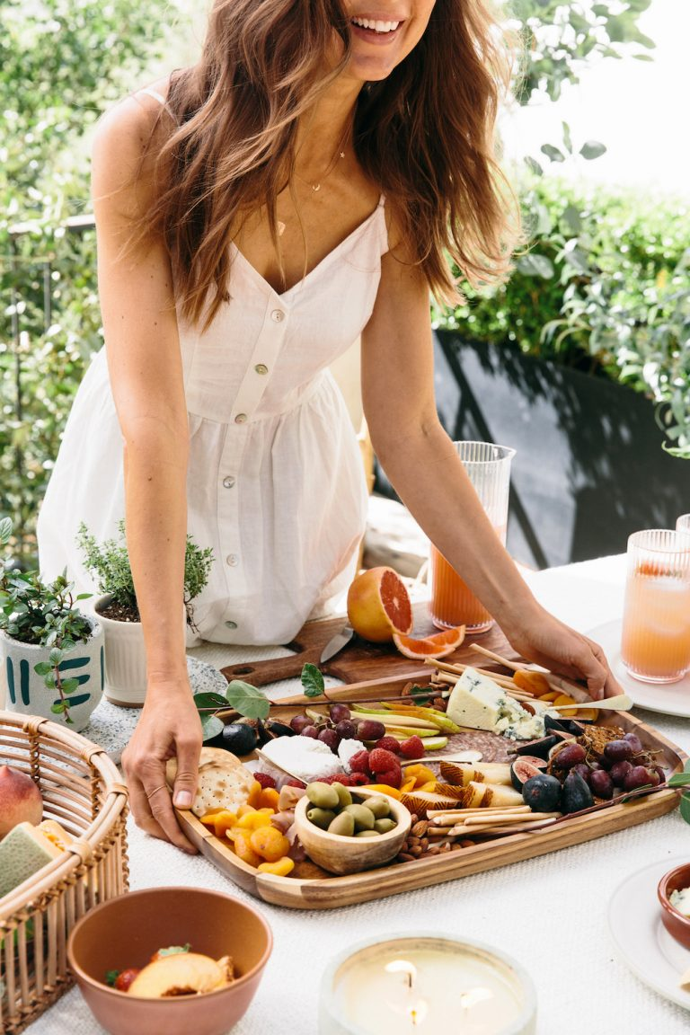 Camille Styles - cheese board on table - appetizers - how to get beachy waves