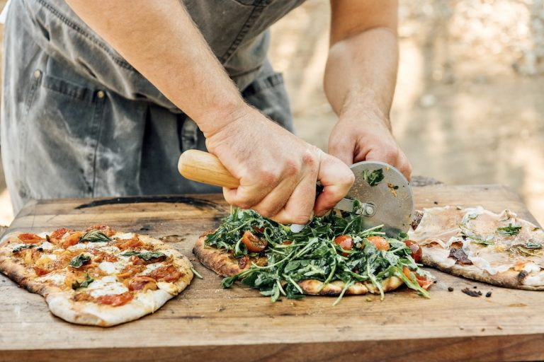 Chef Oliver English making pizza on the pizza oven at Plumcot Farm in Malibu