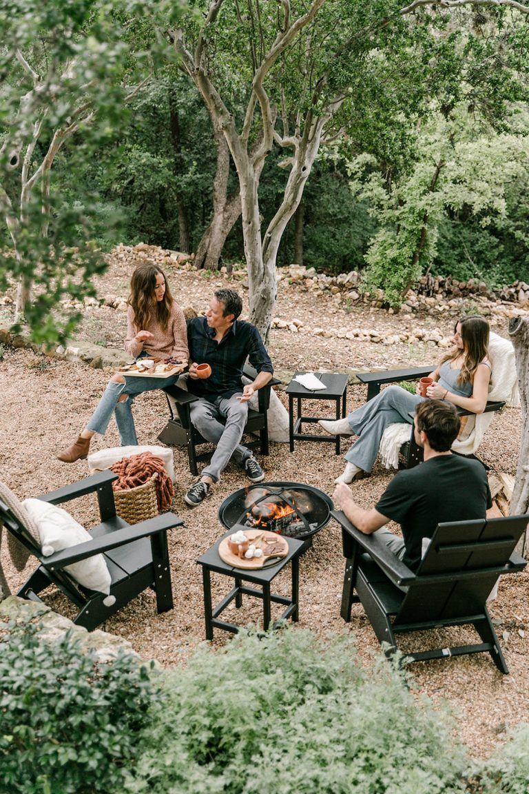 friends hanging out around fire pit with s'mores, backyard game night to celebrate fall with target, cozy, blankets and throws