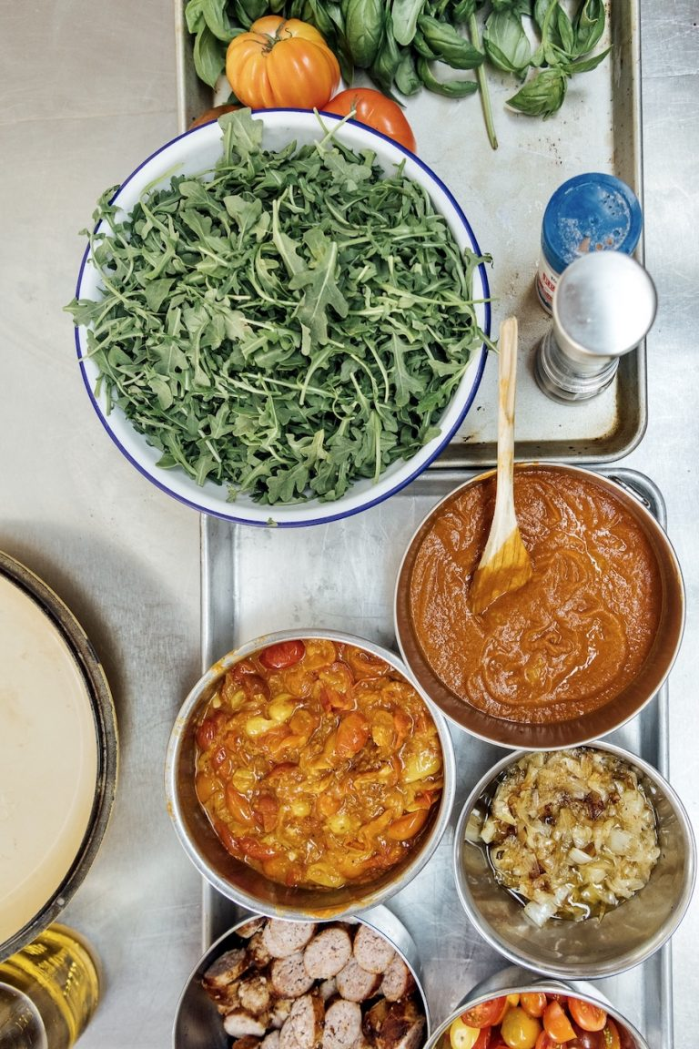 overhead shot of farm fresh summer ingredients and produce, meal prep, arugula, tomato sauce, Italian night