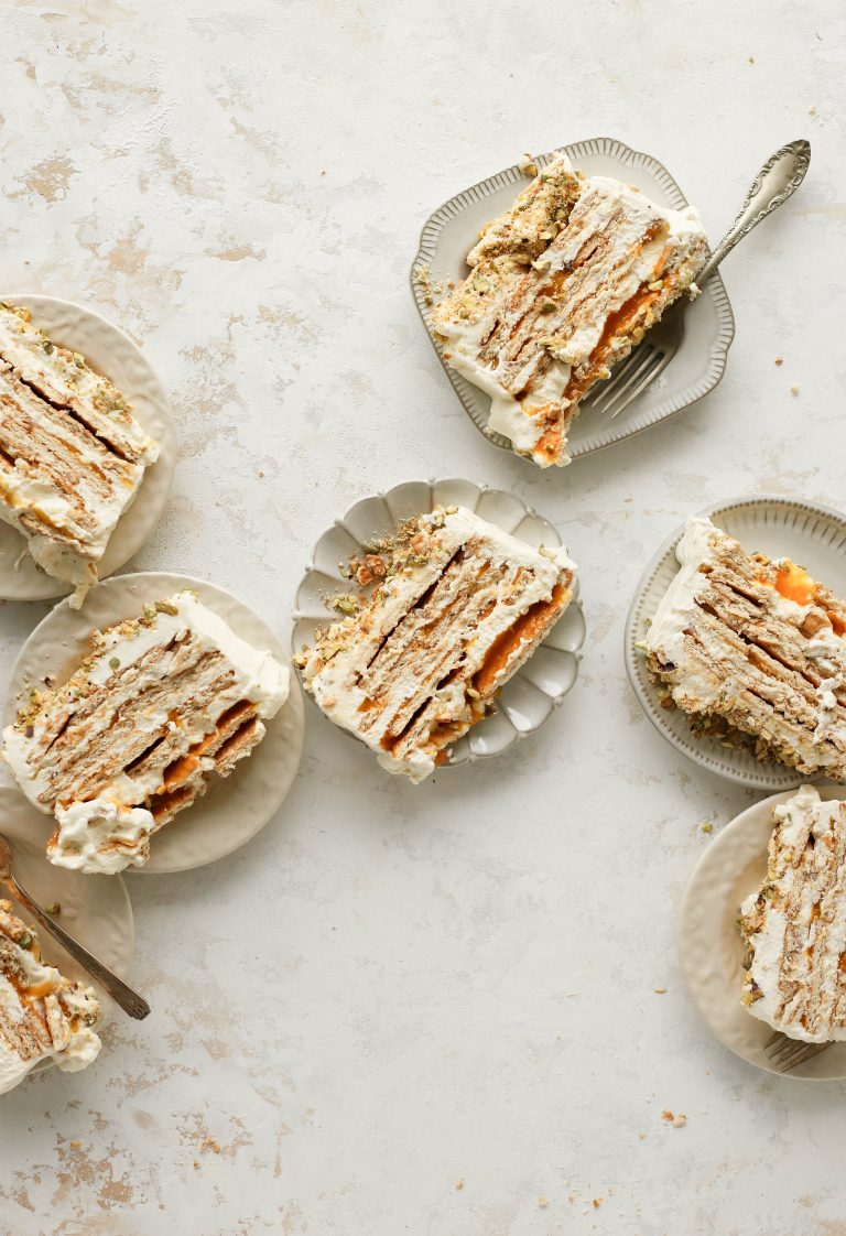 celebrate summer with this no bake mango and cardamom cream icebox cake with a salty pistachio crumble