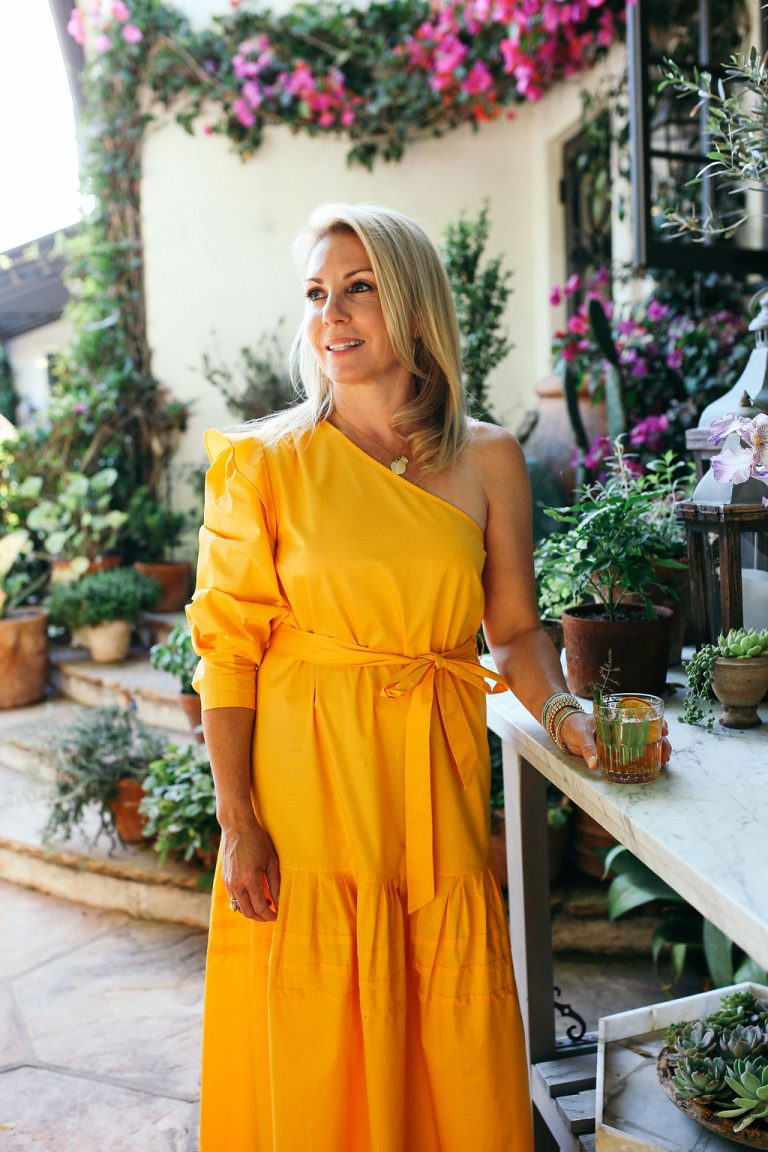Valerie Rice dinner party, yellow dress, host