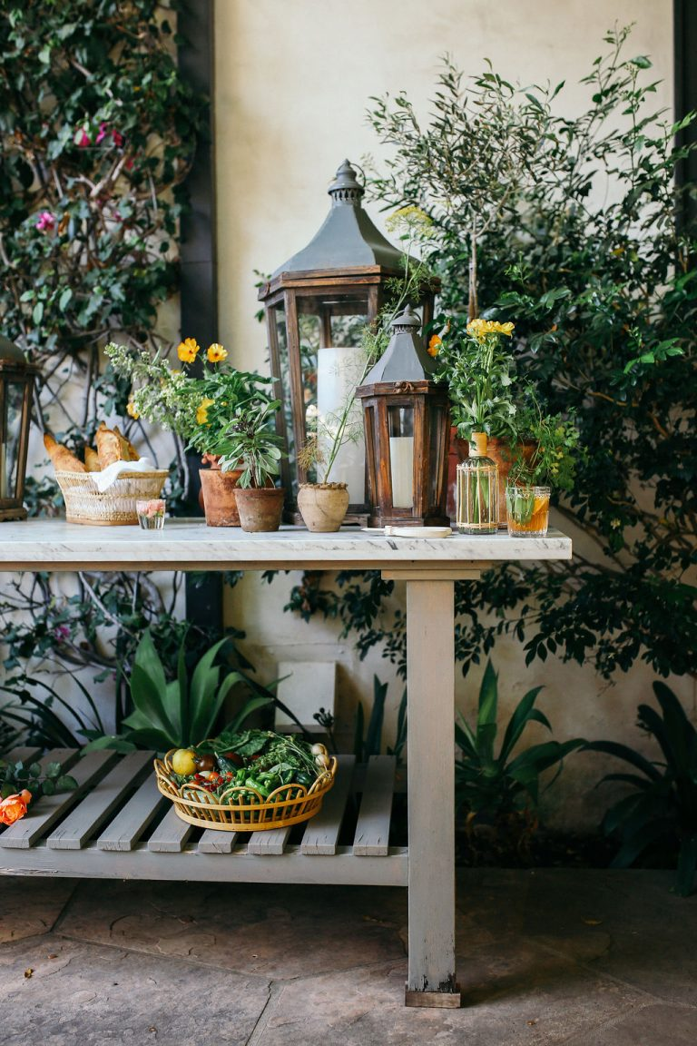 Valerie Rice dinner party in Santa Barbara, bougainvillea and mediterranean house exterior, bar on potting bench setup