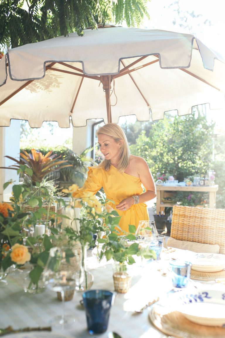 Valerie Rice dinner party, yellow dress, host, setting the table